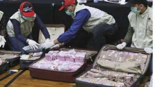 Officers show the suitcases filled with cash
