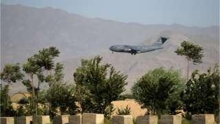 A US Air Force transport plane lands at the Bagram Air Base in Bagram on July 1, 2021
