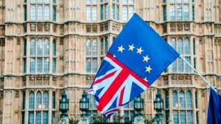 EU and UK flag outside Parliament
