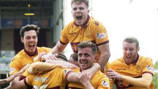 Motherwell players celebrate Allan Campbell's goal
