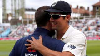 Alastair Cook hugs a colleague at The Oval