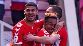 Britt Assombalonga of Middlesbrough scores the opening goal 1-0 past Goalkeeper Adam Federici of Stoke City and celebrates