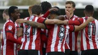 Brentford players celebrate against Sunderland