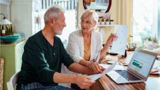 Couple discuss bills - stock shot