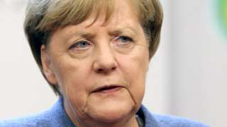 German acting Chancellor Angela Merkel gives a press conference during a EU summit in Brussels