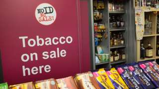 Shutter hiding tobacco products from view