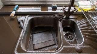 Flood dirty kitchen sink, after Storm Dennis