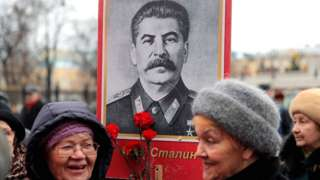 Women holding Stalin portrait in Moscow, 5 Mar 19