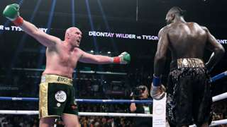 Tyson Fury (left) fighting Deontay Wilder (right)