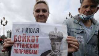 A protester in St Petersburg holds a photo of Russian President Vladimir Putin pictured as a tsar. Photo: 1 July 2020