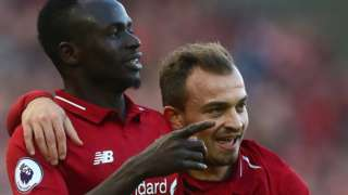 Sadio Mane celebrates scoring for Liverpool against Cardiff City
