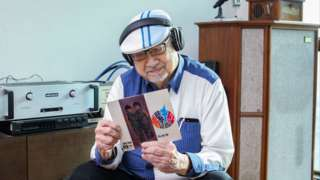 """Radio host Ray Cordeiro aka """"Uncle Ray"""" pictured at his home in Kowloon Tong (11 December 2017)"""