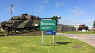 Castlemartin Range entrance with sign and tank