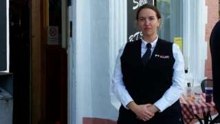 Woman in security unfirom