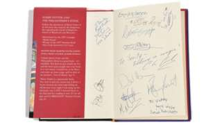Cast autographs on the auctioned Harry Potter book