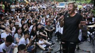 Denise Ho performs during a free concert in Hong Kong on June 19, 2016 after cosmetics giant Lancome cancelled a concert featuring the local singer, who is critical of China