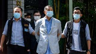 Police lead Hong kong pro-democracy media mogul Jimmy Lai (C), 72, away from his home