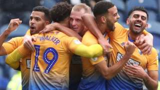 Mansfield celebrate their opener against Notts County