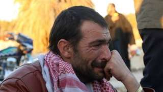 A Syrian man cries after his evacuation from eastern Aleppo. Photo: 15 December 2016