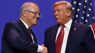 Scott Morrison shakes Donald Trumps hand during a visit to a US factory opening as part of a state visit in September 2019