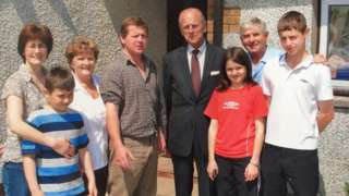 The Reed family with the Duke of Edinburgh when he visited the herd