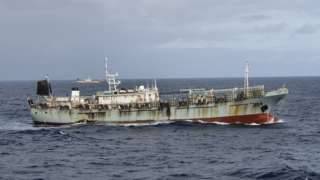 """One vessel, part of a fleet of hundreds of Chinese fishing boats, sails in Pacific Ocean international waters near Chile""""s exclusive economic maritime zone, on the outskirts of the coast of Arica and Parinacota region November 30, 2020. Picture taken November 30, 2020."""