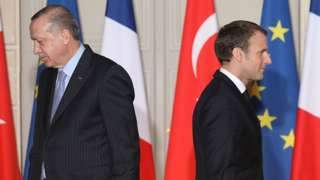 Macron and Erdogan walk during a joint press conference at the Elysee Palace in Paris in 2018