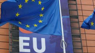 An EU flag flutters outside the European Commission headquarters in Brussels. Photo: 15 October 2020