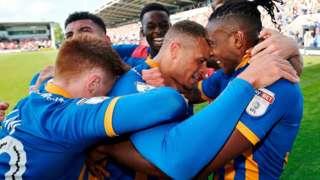 Shrewsbury celebrate Carlton Morris' goal
