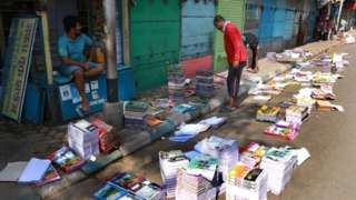 Books laid out to dry in the sun