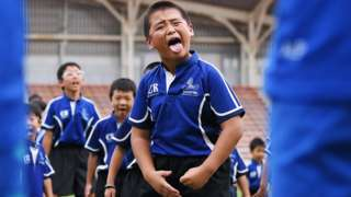 Children perform a haka in front of New Zealand's players during a fans event at Kashiwanoha Park Stadium in Kashiwa