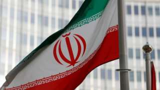 Iran's national flag flutters in front of the International Atomic Energy Agency's headquarters in Vienna, Austria. File photo