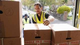 Men unloading a lorry