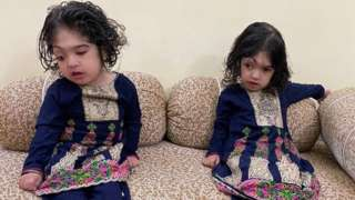The twins play at home in Pakistan