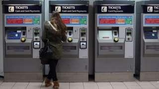 Woman buying rail ticket