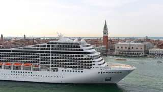 The MSC Magnifica cruise ship is seen from San Maggiore's bell tower leaving in the Venice Lagoon on June 9, 2019.