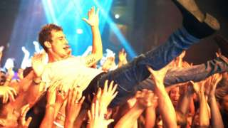 Crowd-surfing at a concert