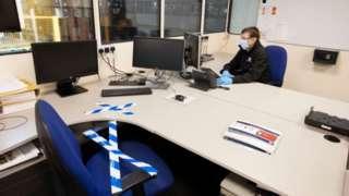 man in office wearing PPE