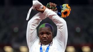 Shot put silver medallist Raven Saunders of the United States gestures on the podium