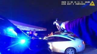 Police officer points gun in fatal shooting