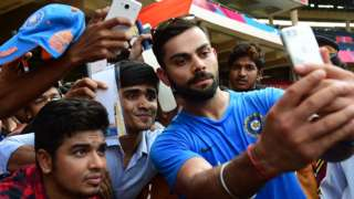 Virat Kohli poses for a photo with fans