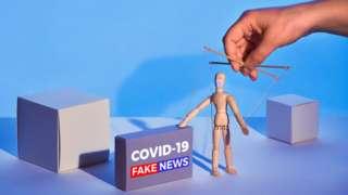 Ilustração gráfica mostra boneco de madeira controlado por mão, como um fantoche, ao lado de caixa que diz: 'Covid-19 Fake news'