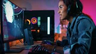 Girl gamer on computer