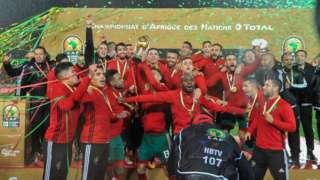 Morocco dey celebrate with dem trophy