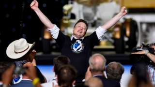 SpaceX CEO and owner Elon Musk celebrates after the launch of a SpaceX Falcon 9 rocket and Crew Dragon spacecraft