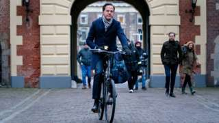 Dutch Prime Minister Mark Rutte arrives by bike for the Council of Ministers at the Binnenhof in The Hague, The Netherlands