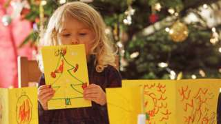 Child making Christmas cards