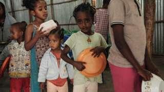 Children wait in line for breakfast in the capital of Tigray region