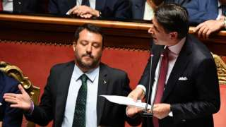 Italian Prime Minister Giuseppe Conte (R) is flanked by Deputy Prime Ministers Matteo Salvini (L)