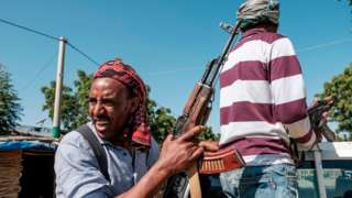 Members of the Amhara militia ride in the back of a pick up truck, in Mai Kadra, Ethiopia, on November 21, 2020. - Amharas and Tigrayans were uneasy neighbours before the current fighting, with tension over land sparking violent clashes. That Mai-Kadra is now being run,at least temporarily, by Amharas provides relief to Amharas, even as it deepens Tigrayan fears of occupation. (Photo by EDUARDO SOTERAS / AFP) (Photo by EDUARDO SOTERAS/AFP via Getty Images)